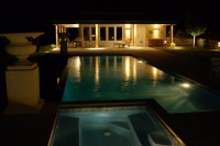 The pool lit up at night.